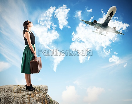 tourists watch the aircraft takeoff