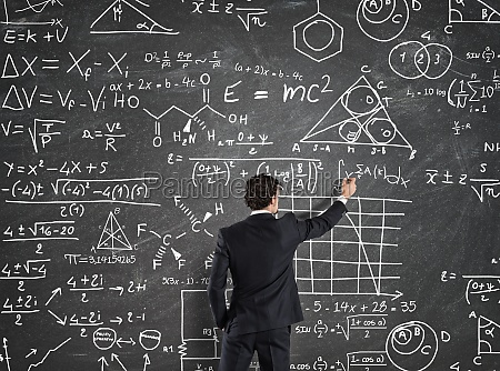 businessman solve problems with math calculations