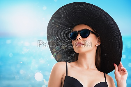girl with hat and sunglasses at