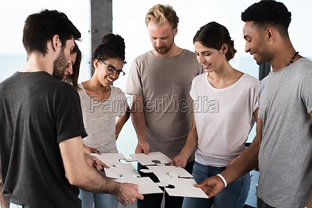 team of businessmen work together for