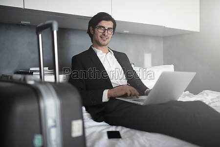 businessman ready to travel works with