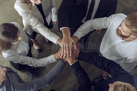 business people putting their hands together