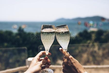 crop anonymous couple enjoying summer holidays