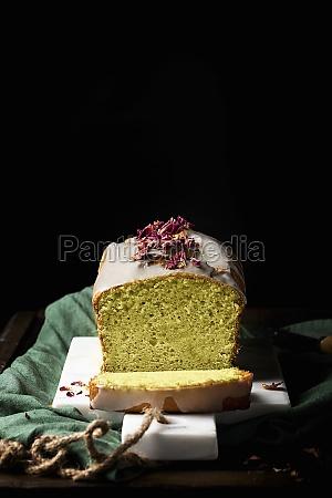 homemade cake with glaze and flower