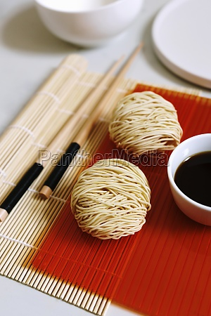 balls of dried noodles with soy