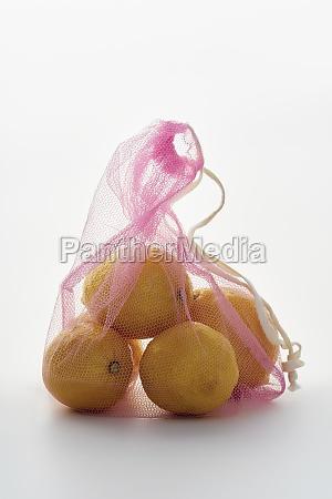 lemons in pink net textile bag