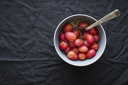 marinated grape tomatoes in bowl