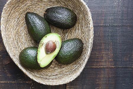 bowl with fresh avocados