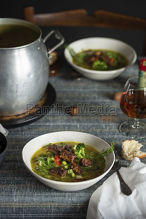 hot soup with green herbs and