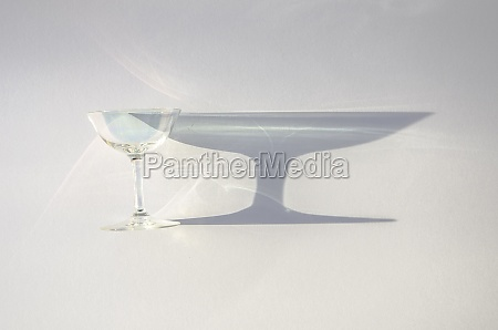stemmed glass with a shadow