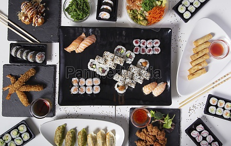 assorted sushi and asian food