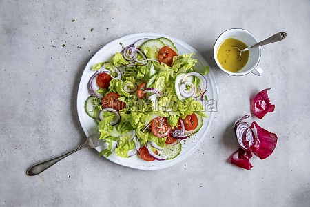 mixed salad with tomatoes and red