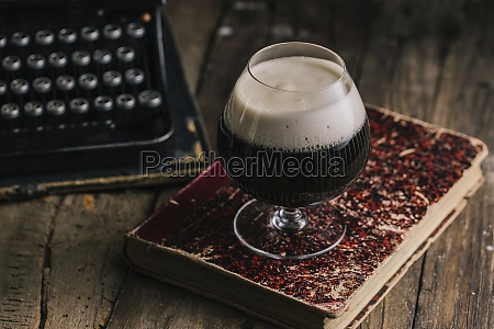 a glass of dark stout beer