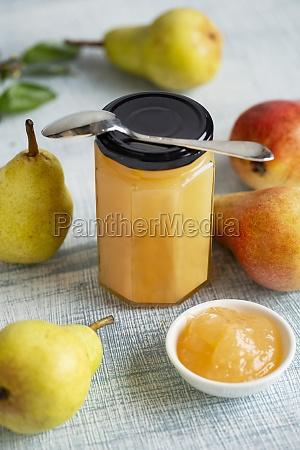 homemade pear jam and fresh pears