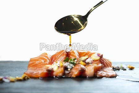 spoon of soy sauce over raw
