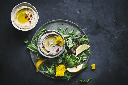 babaganoush and hummus with green leaf
