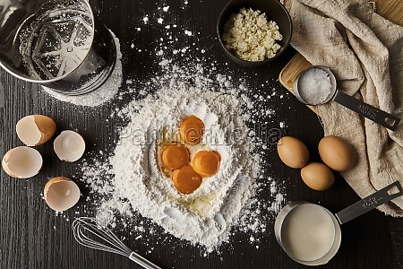 egg yolks in flour on with