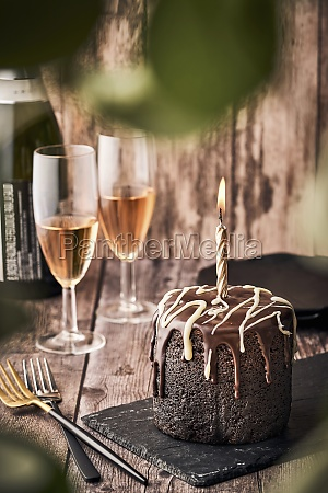 chocolate cake with burning candle and