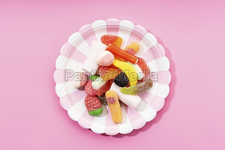 multicolored gummy candies on striped plate