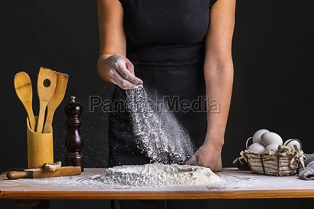 sprinkling flour on bread dough