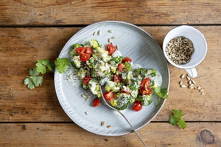 broccoli salad with cherry tomatoes and