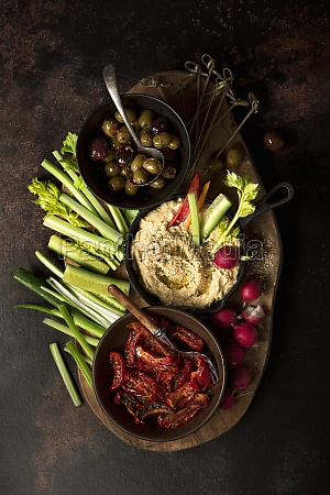 grazing platter with hummus olives sun
