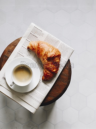 breakfast croissant cup of coffee and