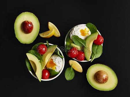 small breakfast bowls with egg avocado