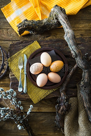 easter table setting with eggs on