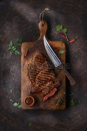 grilled steak on a ceramic and