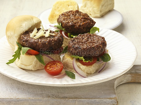mini burgers with a tomatoes and