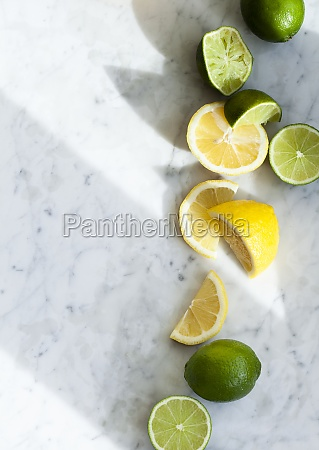 lemons and limes whole halved and