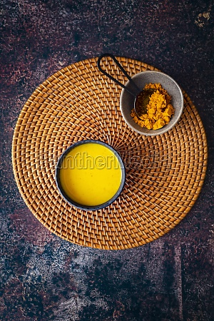 turmeric golden milk on woven grass