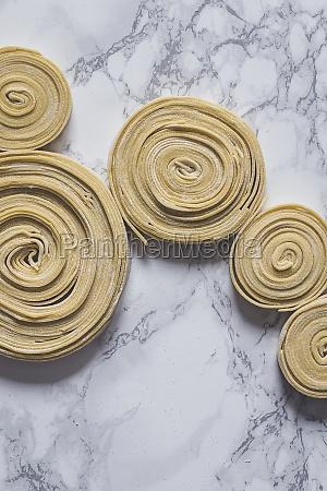 fresh uncooked pasta swirls