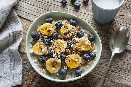 muesli with bananas blueberries and honey