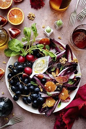 fruits red chicory radish and walnuts