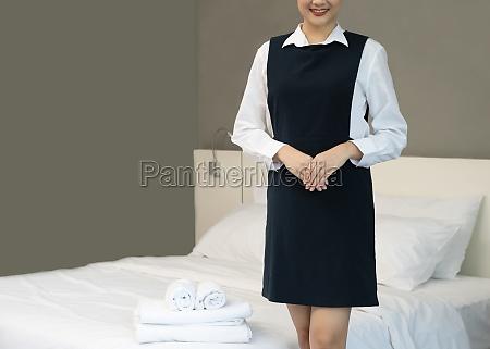 hotel female chambermaid in uniform at