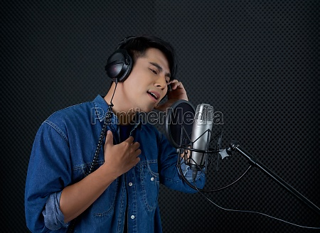young asian man with headphones