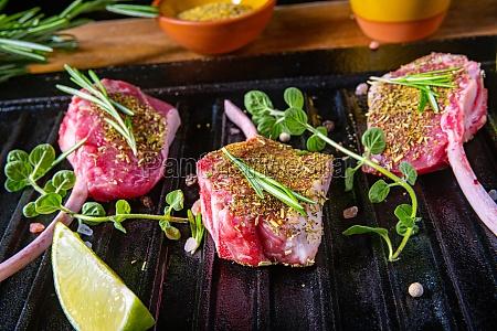 seasoned and herb marinated raw lamb