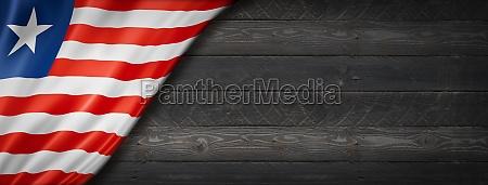 liberian flag on black wood wall