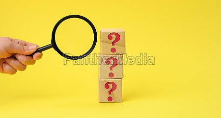 wooden cubes with question marks and
