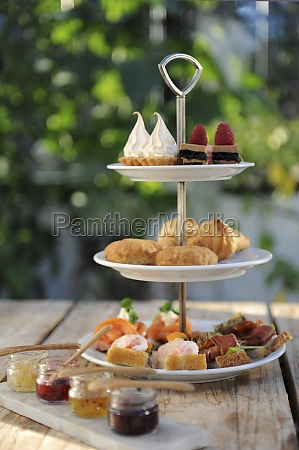 various canapes and sweet pastries on