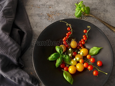 various mini tomatoes with basil in