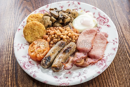 traditional english breakfast with bacon sausages