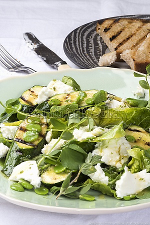 a salad with grilled zucchini beans