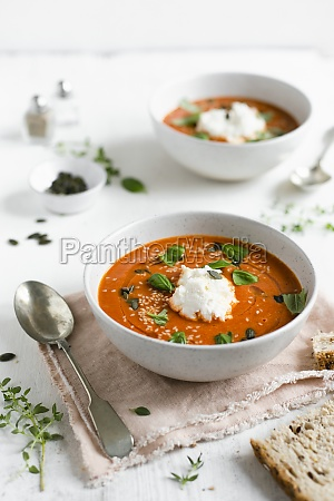 a bowl of roasted tomato soup