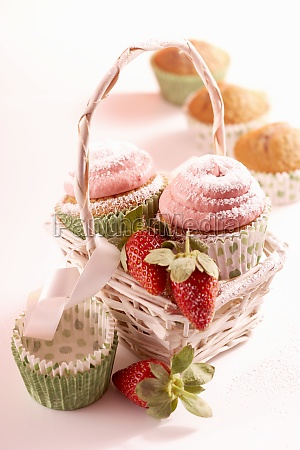 small strawberry cupcakes with powdered sugar