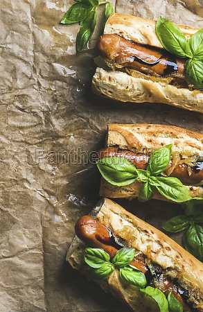 homemade grilled sausage dogs in baguette