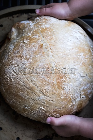 fresh bread with little child hands