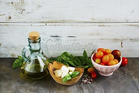 tomato mozzarella basil leaves and olive